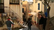 People walking down narrow alley with souvenir shops Stock Footage