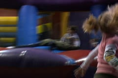 Kids Running in Inflatable Arena - stock footage