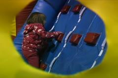 Kids Climbing Up Wall - stock footage