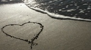 Stock Video Footage of Heart drawn in the sand (with wave)