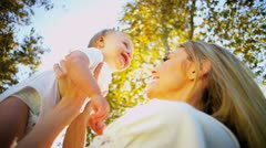 Blonde Mom and Baby Laughing Outdoors Stock Footage