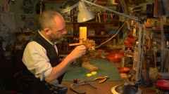 Clockmaker restoring clock mechanism on a jig - stock footage