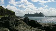 Stock Video Footage of cruise ship going away - rocky coast