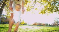 Stock Video Footage of Mom with Baby Taking First Steps