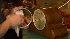 Clockmaker cleaning a clock which has just been restored. Stock Footage