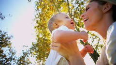 Blonde Mom and Baby Laughing Outdoors - stock footage
