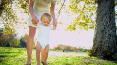Happy Baby Taking First Steps Stock Footage