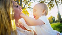 Young Mom Outdoors With Baby  Stock Footage