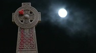 Stock Video Footage of Timelapse clouds with full moon flowing past graveyard statue