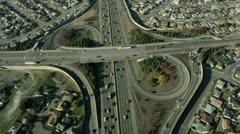 Aerial view of suburban traffic on busy freeway - stock footage