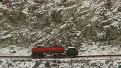 Truck on mountain highway in winter - stock footage