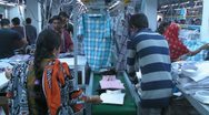 Stock Video Footage of Sorting Produced Garments