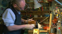Clockmaker polishing a clock case, with audio Stock Footage