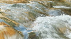 Water flowing down the river, camera lock down Stock Footage