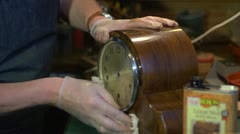 Clockmaker polishing a wooden clock, with audio Stock Footage