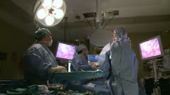 Stock Video Footage of Surgeons watch monitor while performing laparoscopic surgery (12of 18)