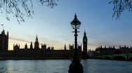 Stock Video Footage of Houses of Parliament, London. Tracking time lapse at sunset. Wide, short version