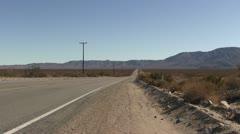 ROAD2VEGAS-0030 DESERTED ROAD IN THE DESERT - stock footage
