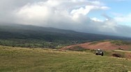 Stock Video Footage of Landrover 4x4 vehicle driving up a steep hillside