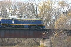 Stock Video Footage of Train Leaving Bridge