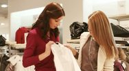 Stock Video Footage of Girls picking shirt