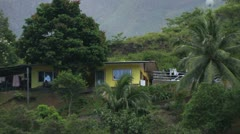 House on an Island Hillside Stock Footage