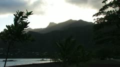 Sun Behind Island Mountains - stock footage
