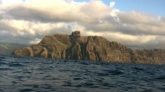 Towering Island Cliffs From Boat Stock Footage