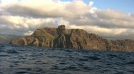 Stock Video Footage of Towering Island Cliffs From Boat