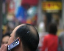 Man on Cellphone and Many People in Tokyo, Japan GFSD Stock Footage