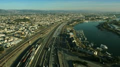 Aerial view of  rail tracks and freeway, San Francisco, USA - stock footage