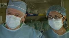 Surgeons performing surgical tasks (3 of 10) Stock Footage