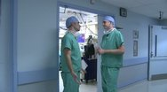 Surgeons look ahead at their schedule Stock Footage