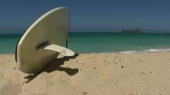 Surfboard on a beach - stock footage