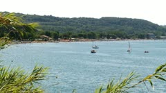 Lake with boats in the summer wide shot Stock Footage
