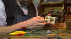 Clockmaker working on a carriage clock - tapping with hammer Stock Footage