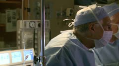 Surgeons performing surgical tasks (1 of 10) Stock Footage
