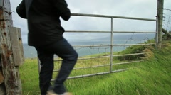 Walking through Sheep Gate, Ireland GFHD Stock Footage