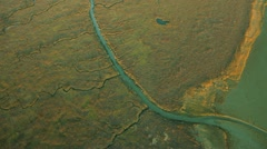 Aerial view of wetlands salt ponds rich in mineral deposits  Stock Footage