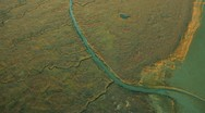 Aerial view of wetlands salt ponds rich in mineral deposits  Stock Footage