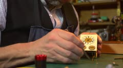 Clockmaker setting hands on a carriage clock - close up Stock Footage
