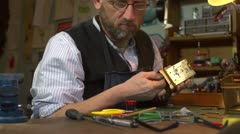 Clockmaker working on a carriage clock - closing the case with screwdriver Stock Footage