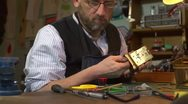 Stock Video Footage of Clockmaker working on a carriage clock - closing the case with screwdriver