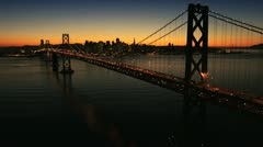 Aerial sunset view of the Oakland Bay Bridge, USA Stock Footage