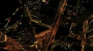 Stock Video Footage of Aerial night vertical rooftop view of Skyscrapers, USA