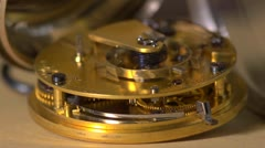 Stock Video Footage of Close up of an Earnshaw watch movement - seamless loop.