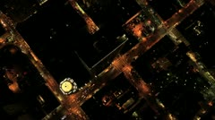 Stock Video Footage of Aerial night vertical rooftop view of city buildings and traffic, USA