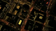 Aerial night vertical rooftop view of city skyscrapers, USA - stock footage