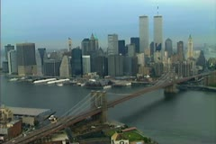 Aerial shot of the Brooklyn Bridge and World Trade Center twin towers Stock Footage
