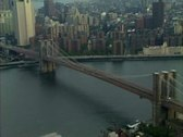 Stock Video Footage of Aerial shot of Brooklyn Bridge with zoom out to Manhattan Skyline & twin towers